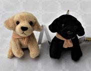 Portes clés chien en peluche noir ou beige